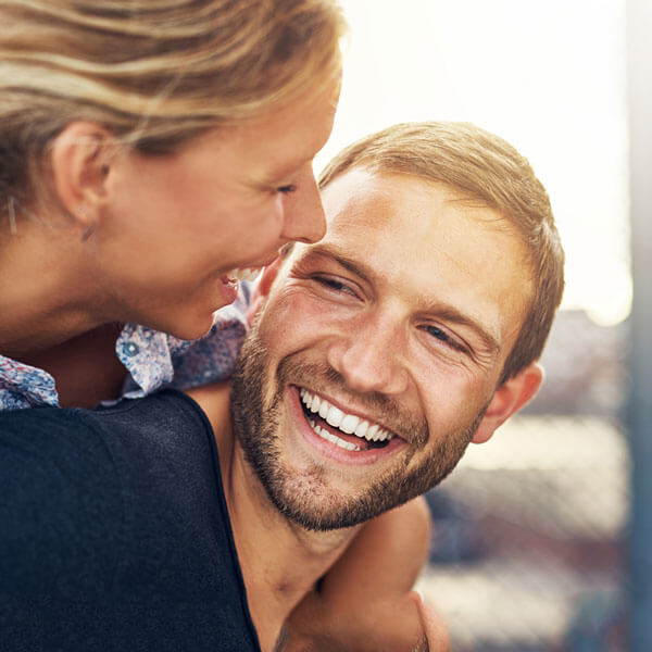 A woman laughing with her partner