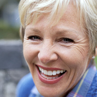 An older woman laughing