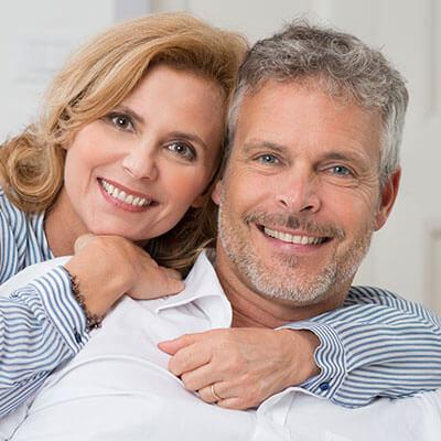 A mature woman hugging her husband