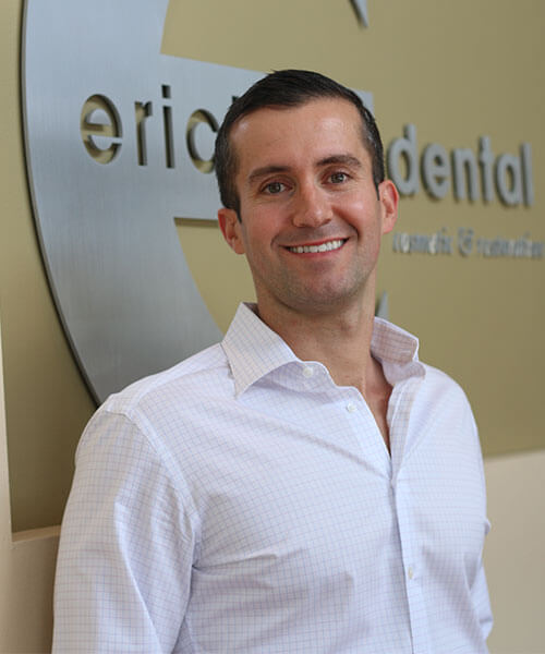 Dr. Jason Erickson inside the dental office in Irving, TX smiling