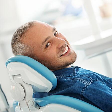 A man reclining in the dental chair at Erickson Dental
