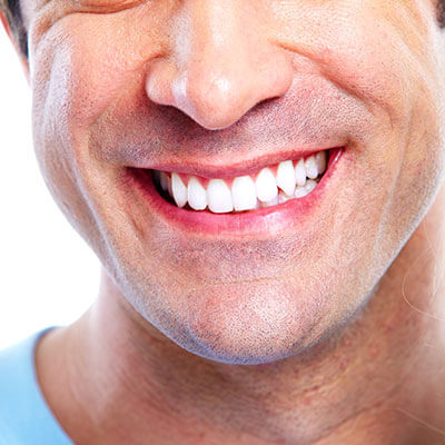 The close-up smile of a man