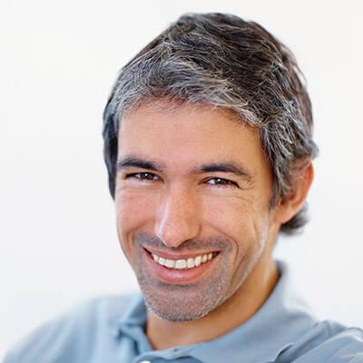 A mature man smiling