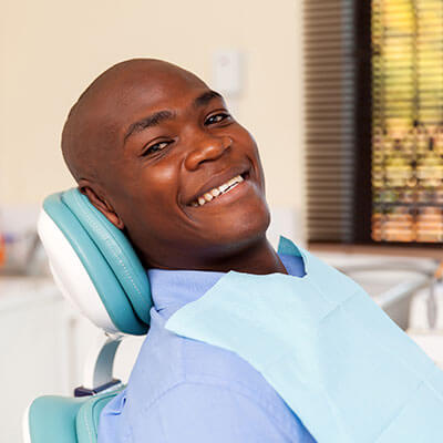 A middle aged man in a dental chair